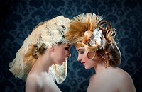 Hairdressing and makeup fashion two woman on dark background