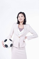 A woman with soccer ball