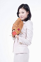 A woman wearing a baseball glove