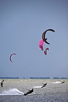 Netherlands, near Bakhuizen, Wind surfers and kite surfers on lake Ijsselmeer