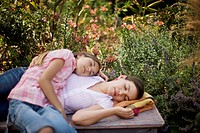 Mother and Daughter Napping in Garden