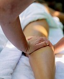 Woman Receiving Massage on Leg