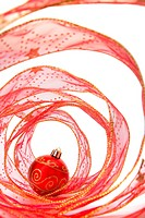 Red Xmas bauble in a red ribbon Spiral