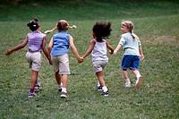 Girls Holding Hands in Field