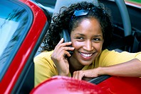 Woman Speaking on Cell Phone in Car