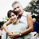 Woman with Arms Around Boy at Picnic
