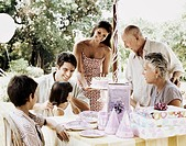 Family Celebrating at Outdoor Birthday Party
