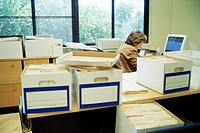 Businesswoman with Boxes of Files