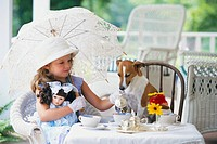 Little Girl Having Tea Party with Dog