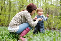 Mother and son playing in forest