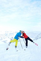 Skiers kissing on snowy mountaintop