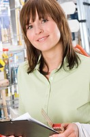 Woman with Clip Board in Hardware Store