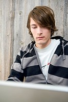 Young Man Looking at Laptop