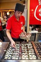 Man cooking Japanese fast food, Shinjuku Ward, Tokyo, Japan