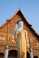 Buddha statue in a stupa at sunrise, Pha That Luang, Vientiane, Laos