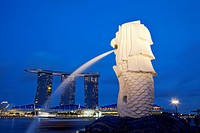 Merlion Statue with a hotel and casino in the background, Sands Hotel and Casino, Singapore City, Singapore