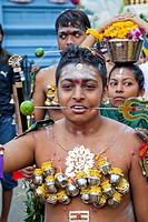 Devotee with pierced body in a religious procession at Thaipusam Festival, Sri Srinivasa Perumal Temple, Little India, Singapore