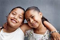 Two smiling Hispanic girlfriends
