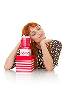 Young woman with stack of gifts