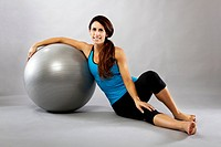 Woman Posing With Exercise Ball In Studio