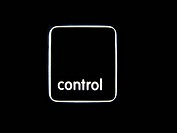 A backlit Control button isolated on a black background
