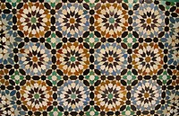 intricate tile design on the Ali ben Youssef Medersa in Marrakech, Morocco