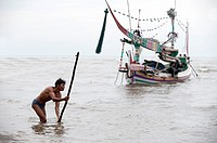 fisherman working in the sea of java, indonesia