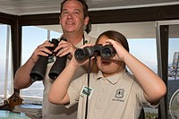 Twin Peaks, California - U S  Forest Service volunteer at the Strawberry Peak fire lookout tower, teaches his daughter, 10, how to spot wildfires