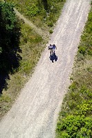 aerial view of a couple walking on a dirt road