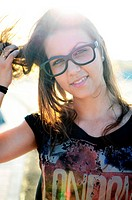 Cute young woman wearing black-rimmed glasses