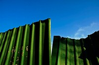 Green corrugated metal fence