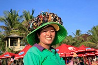A Balinese woman selling jewellery on Kuta Beach The beach sellers usually carry their wares tied together on top of their hat Bali, Indonesia