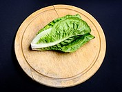 Lettuce on a wooden board