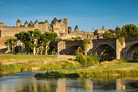 River Aude and Old Bridge 14th Cent leading to Medieval town of Carcassonne, Languedoc-Roussillon, France