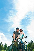 Sport mountain biking couple relax in meadows