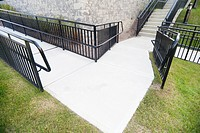 Empty turn in double wheelchair ramp approaching stairs