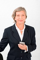 Senior businesswoman smile hold cellphone
