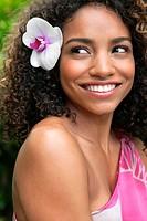 Portrait of woman wearing flower in hair