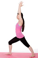 Studio portrait of young Asian woman doing yoga on white background