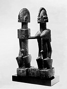 Carved wooden sculpture of an embracing couple, made by the Dogon people of Mali, 19th century.