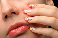 Female face close up and nail art