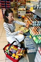 Woman shopping for free-range chicken eggs, self-service, food department, supermarket, Germany, Europe