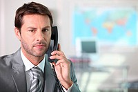Businessman on the telephone with serious expression on face
