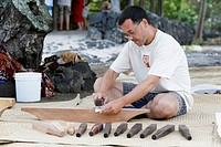 Beating of Kapa fabric, production of traditional Hawaiian cloth made from the inner bark of the paper mulberry tree, Kailua-Kona, Big Island, Hawaii,...