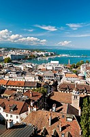 Panoramic view over city rooftops and Lake Geneva, Geneva, Switzerland