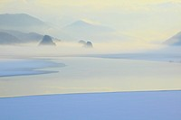 Foggy Scene Of Lake And Mountains