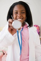Black girl pretending to be a doctor