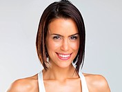 Portrait_ closeup of beautiful brunette woman smiling and looking at camera