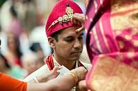 Indian woman marking groom´s forehead