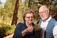 Attractive Senior Couple Overlooking Potted Plants
